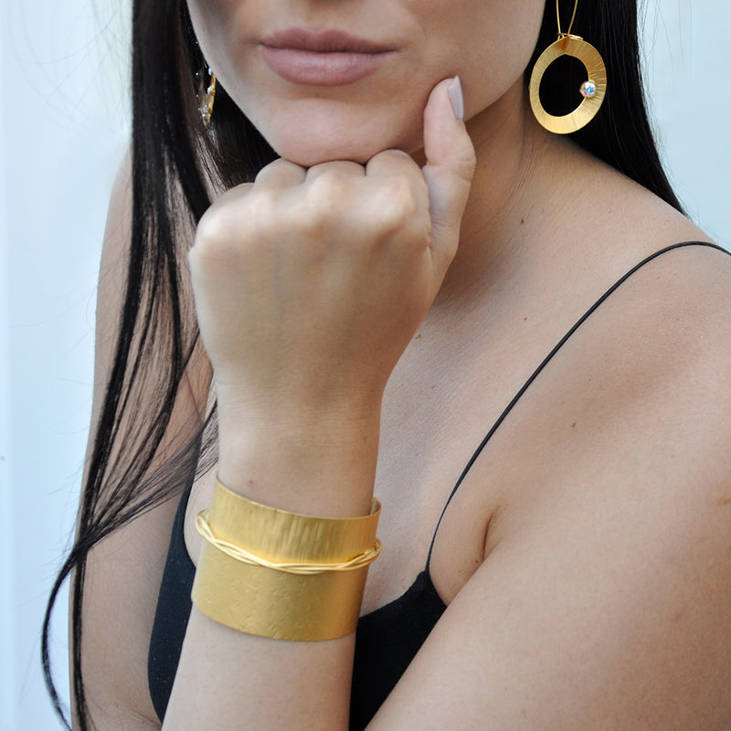 Gold cuff bracelet with texture