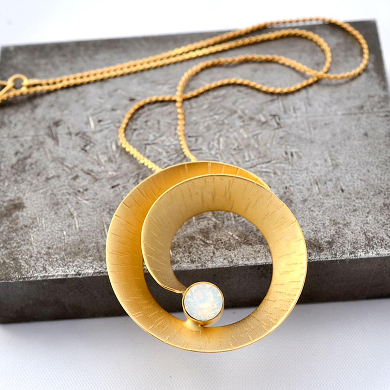 24k gold plated spiral pendant necklace with a white opal Swarovski crystal