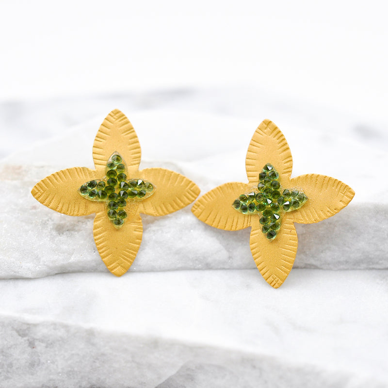 hammered gold flower shape earrings with green Swarovski crystals
