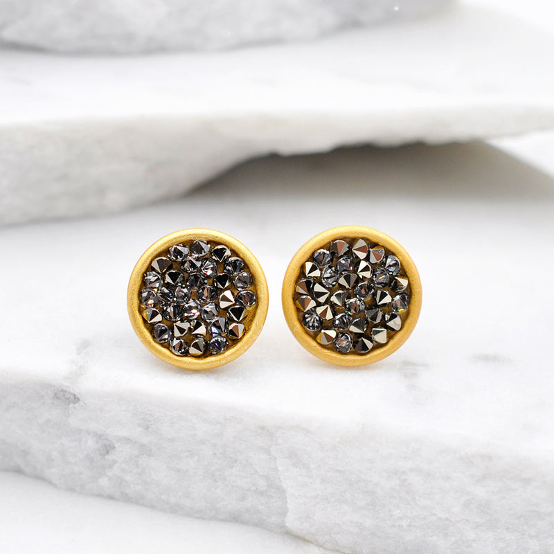 Gold round stud earrings with shiny black Swarovski crystals