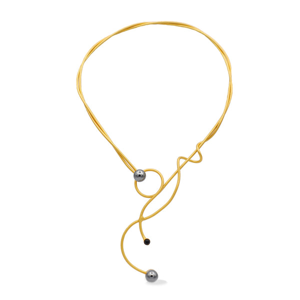 Gold sculptural necklace with black pearls