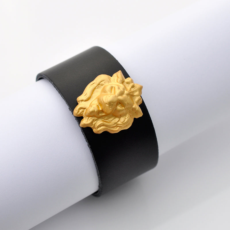 Black leather gold lion cuff bracelet