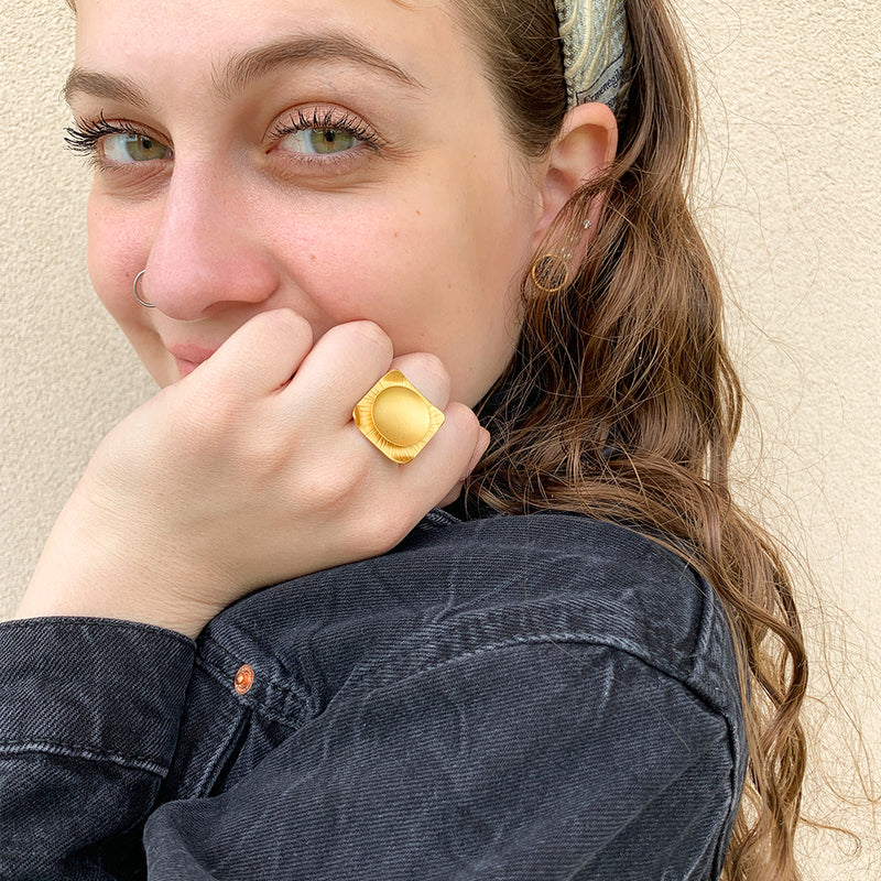 Hammered gold square ring with an loop shape attached