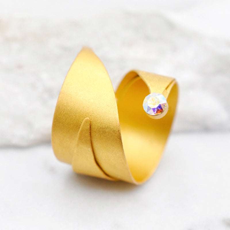 Hammered gold wrapped ring with a Swarovski crystal
