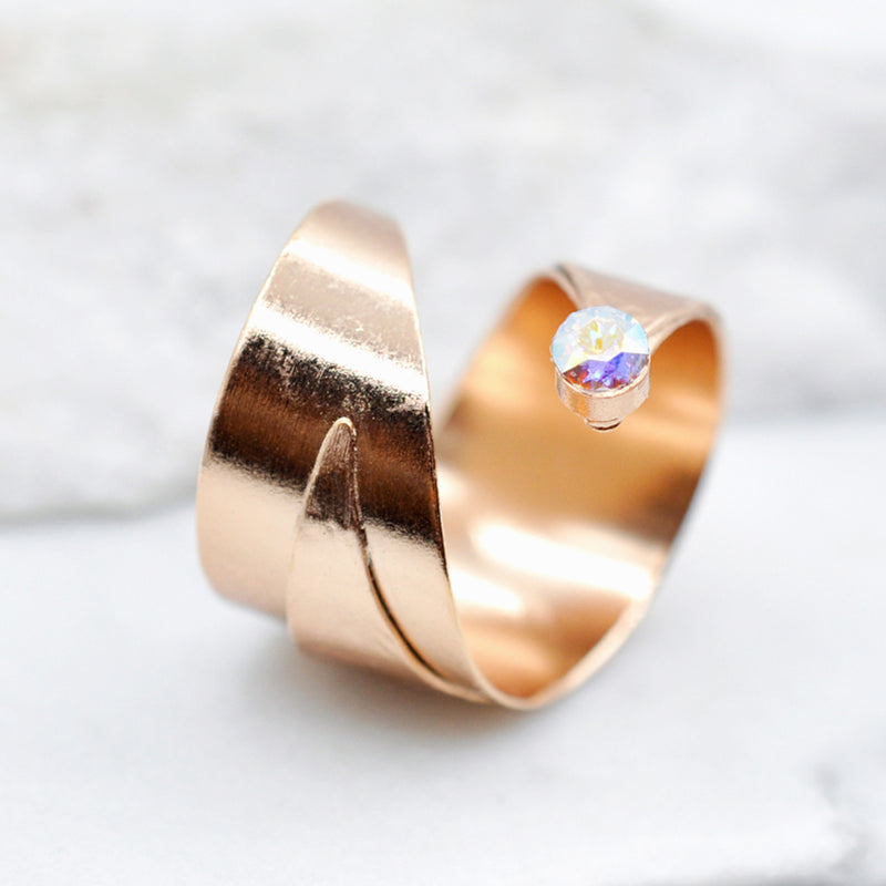 hammered rose gold wrapped ring with a Swarovski crystal