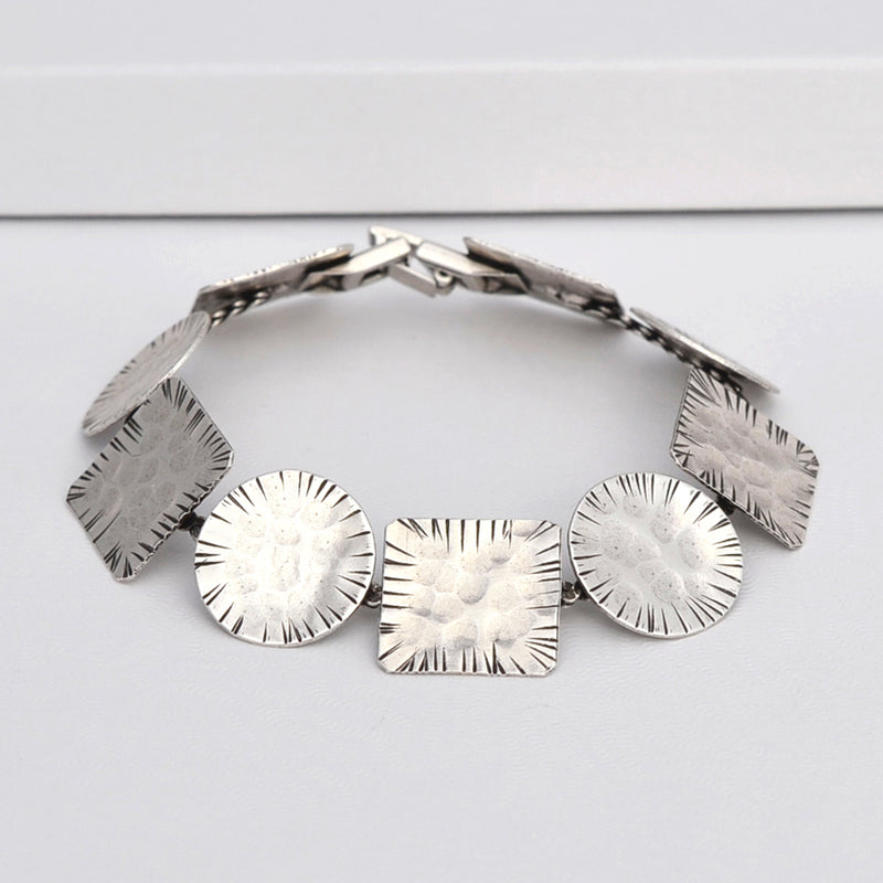 Silver geometrical linked bracelet