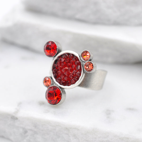 Silver sculptural ring with red Swarovski crystals