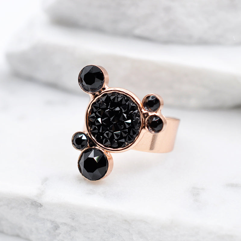 Rose gold statement ring with circular shapes and black Swarovski crystals
