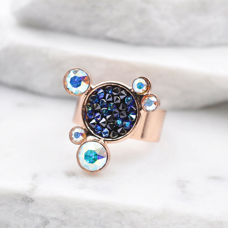 Rose gold statement ring with multiple circular shapes and Swarovski crystals