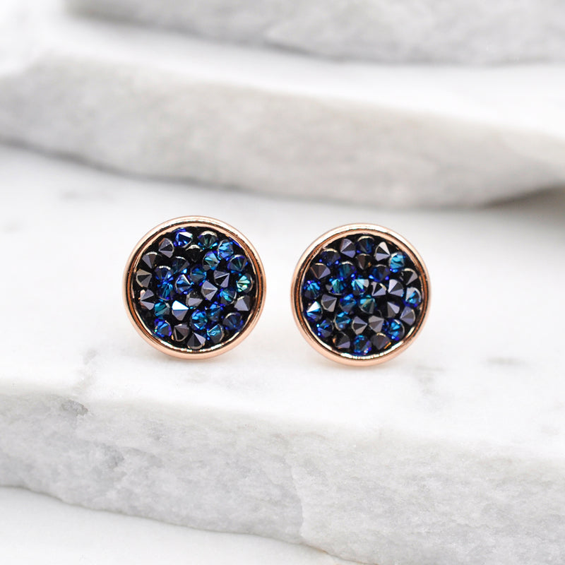 Rose gold round stud earrings with shiny blue Swarovski crystals