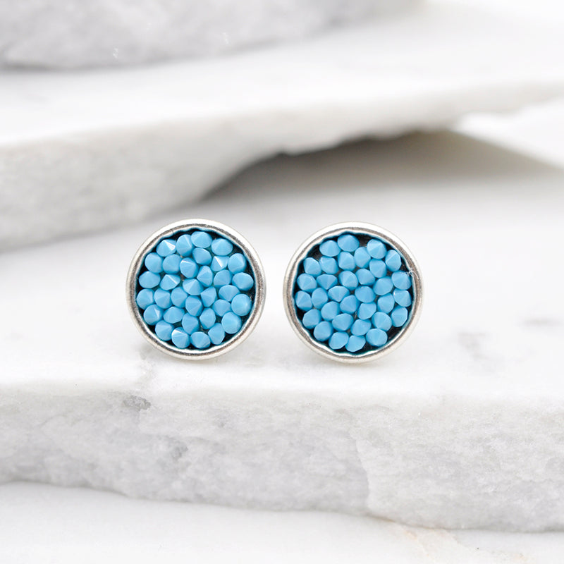 Silver stud earrings with turquoise Swarovski crystals.