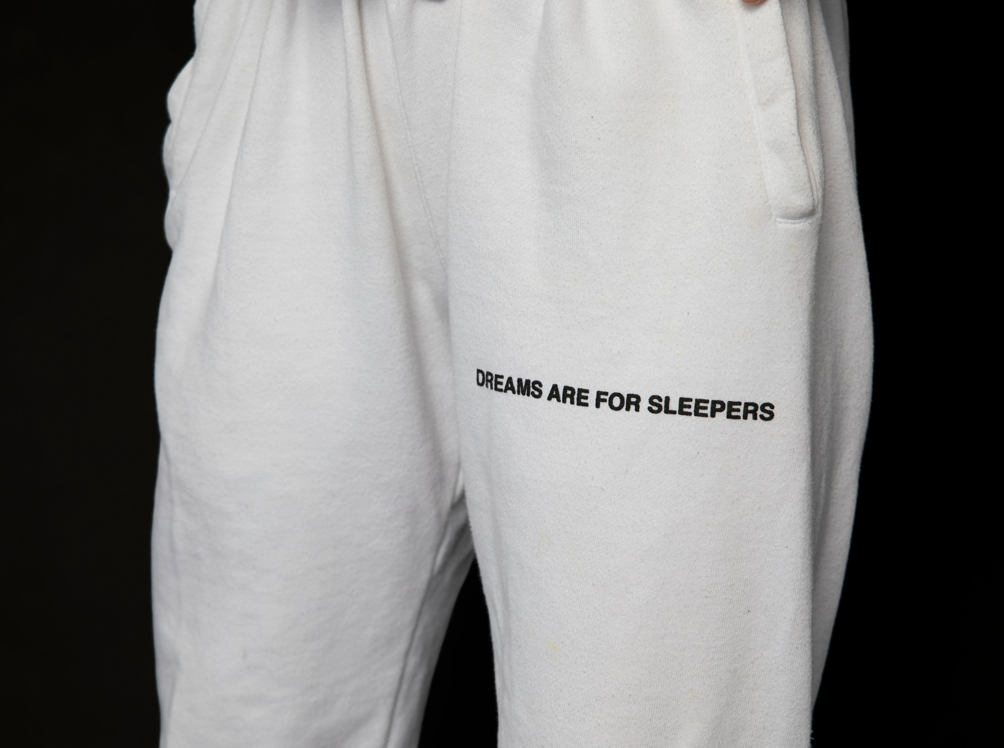 "White ""Dreams are for sleepers"" Sweatpants"