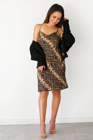 black cardigan and snake print dress