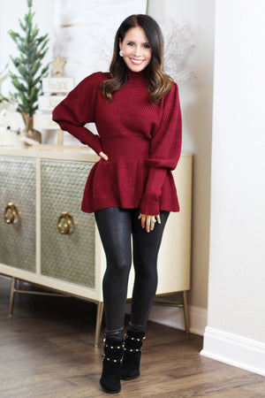 burgundy peplum sweater christmas outfit inspiration