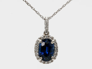 Vibrant Blue Oval Sapphire and Diamond Halo Pendant