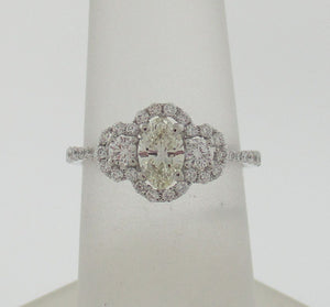 Oval Diamond Halo 3 Stone Ring