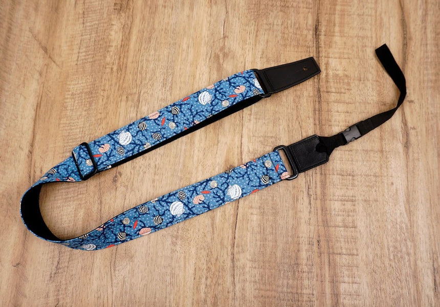 shell on light blue ukulele shoulder strap with leather ends-3