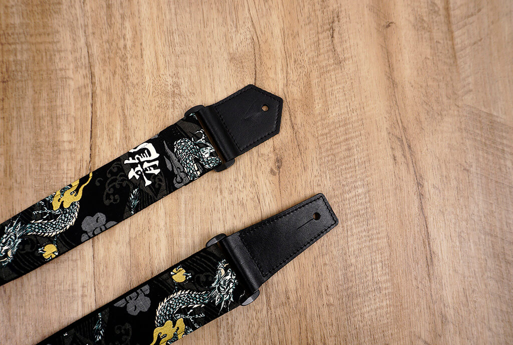 white dragon guitar strap on black with leather ends-4