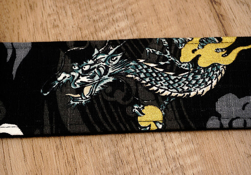 white dragon guitar strap on black with leather ends-5