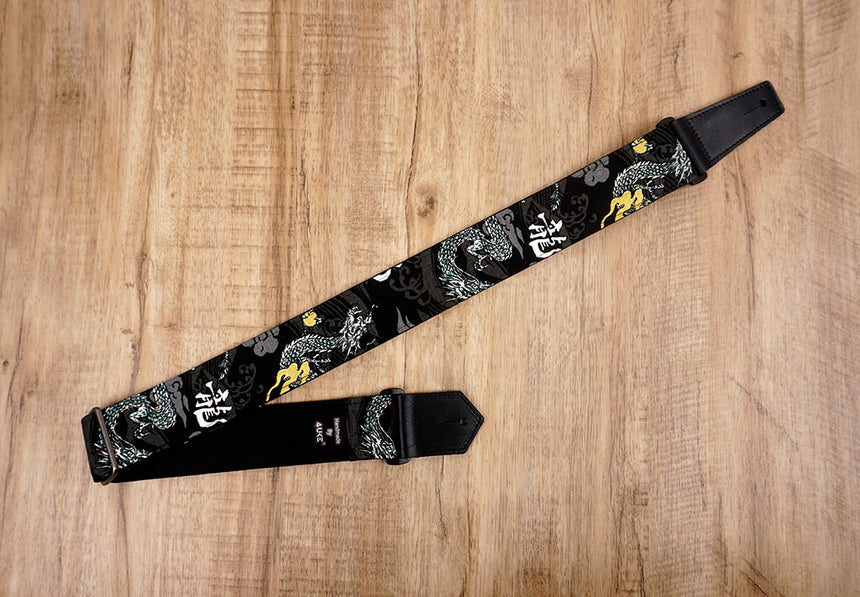 white dragon guitar strap on black with leather ends-2