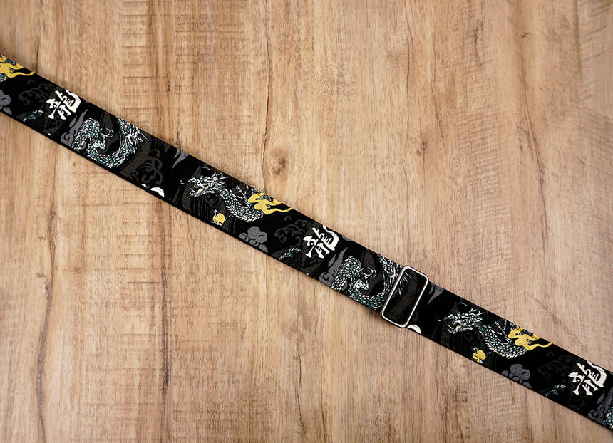 white dragon guitar strap on black with leather ends-6