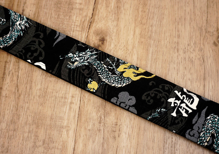 white dragon guitar strap on black with leather ends-7