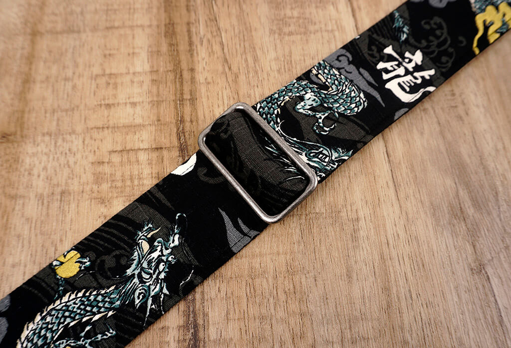 white dragon guitar strap on black with leather ends-8