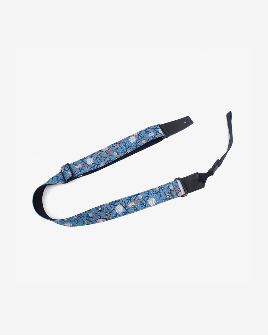 shell on light blue ukulele shoulder strap with leather ends-1
