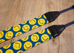 yellow smiley face emoji camera strap