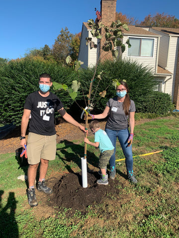 Owners Iliyan and Christie standing by tree