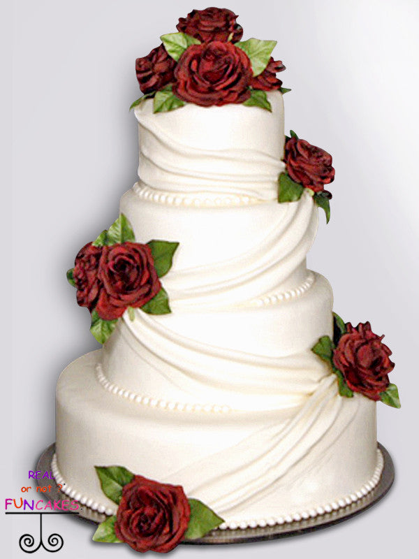 draped with flowers 4 tier cake