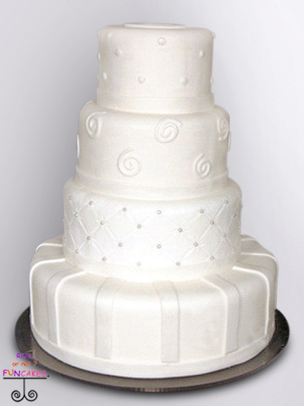 white patterns 4 tier round cake