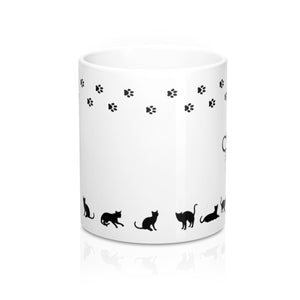 side view of feline fine white mug with cat paw trail and cat shapes