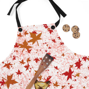 fall leaves and siamese cat apron next to cookies and wooden spatula