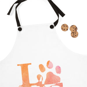 flowers and love cat paw pink and orange apron next to cookies and spatula