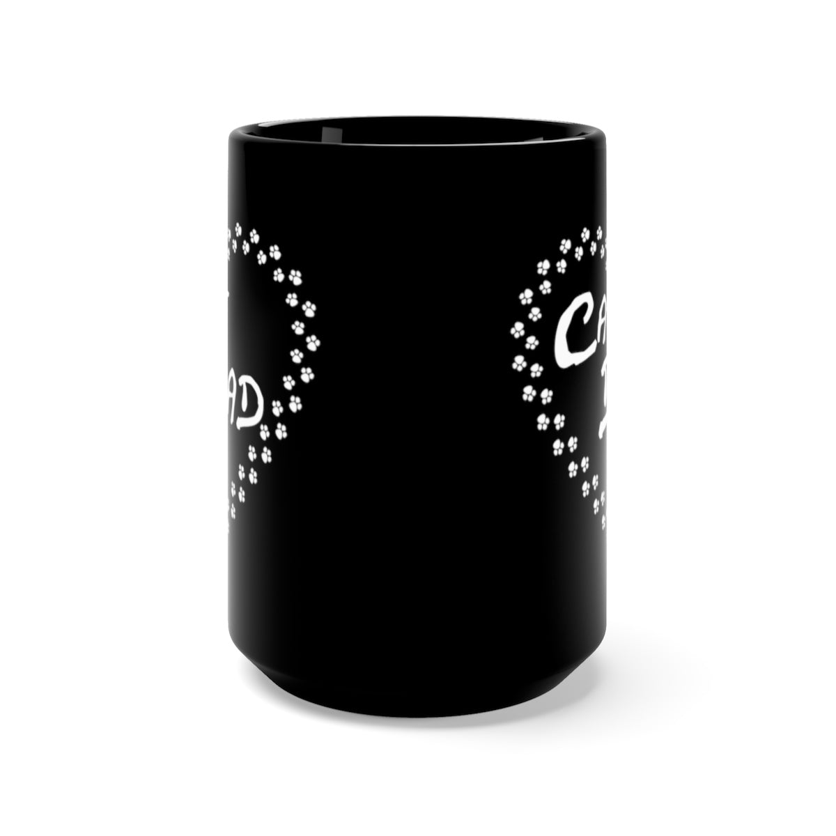 front view of black mug with cat dad white text surrounded by a heart made of cat paws