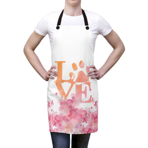 woman wearing flowers and love cat paw pink and orange apron