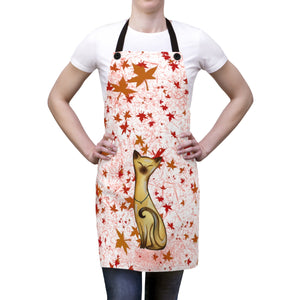woman wearing apron with black straps and fall leaves with siamese cat design