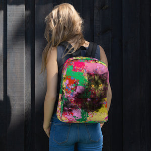 girl wearing colorful backpack with black cat