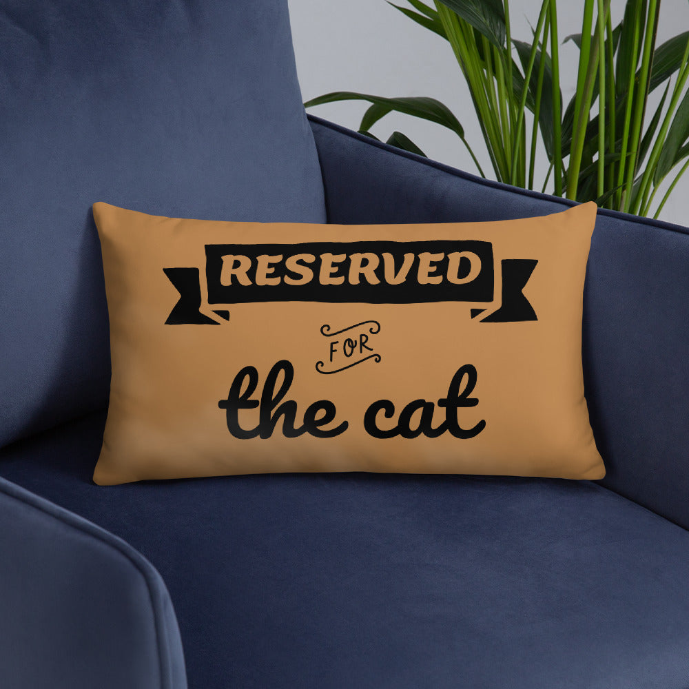 20x12 in nude throw pillow with reserved for the cat text placed on blue sofa