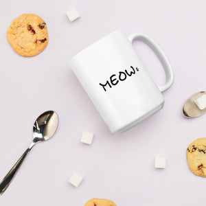 Cat lover white mug with meow text next to cookies and sugar