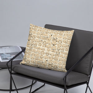 cat pattern nude throw pillow on gray cushioned chair