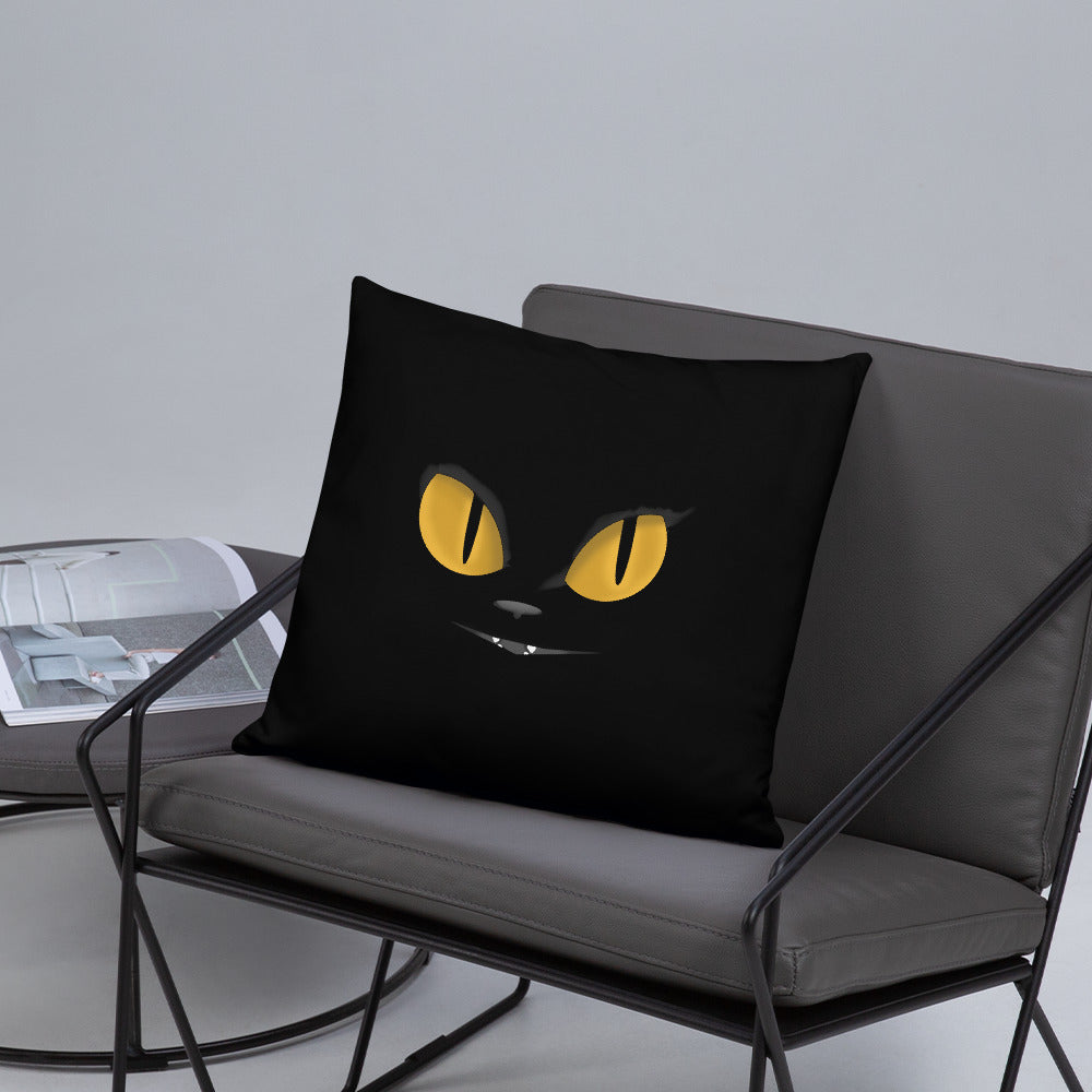 black cat yellow eyes on black throw pillow on gray chair