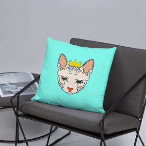 crowned sphynx cat blue green throw pillow on gray cushioned chair