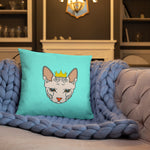 crowned sphynx cat blue green throw pillow on quilt