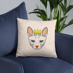 crowned sphynx cat nude throw pillow on blue sofa