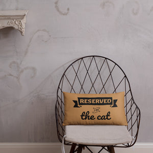 20x12 in nude throw pillow with reserved for the cat text placed on chair