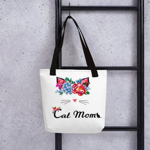 tote bag with black straps and a cat wearing a flower crown above cat mom text design