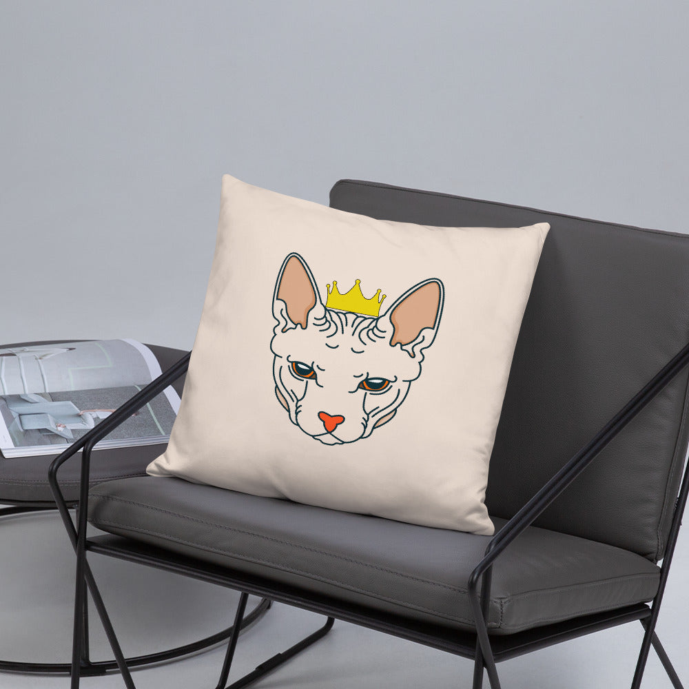 crowned sphynx cat nude throw pillow on gray cushioned chair