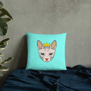 crowned sphynx cat blue green throw pillow on blue covers
